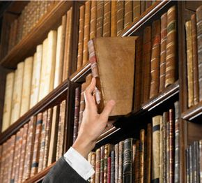Lawyer reaching for law book